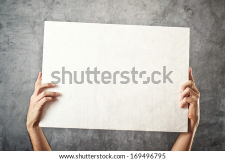 Man holding blank white banner with copy space for your text.