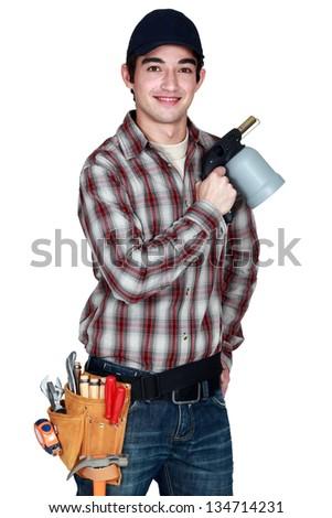 Man holding blowtorch - stock photo