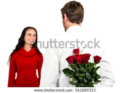 Man holding bouquet of roses with girlfriend on white background - stock photo