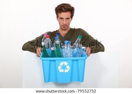 Man holding box full of empty bottles - stock photo