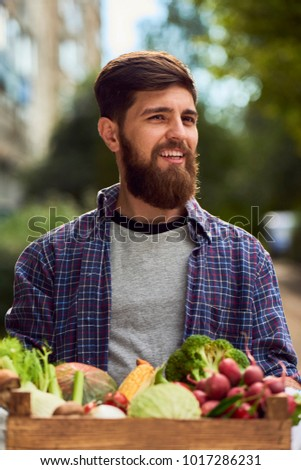 Man holding box with healthy organic vegetables