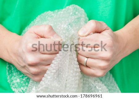 Man holding bubble wrap, stress relief - stock photo