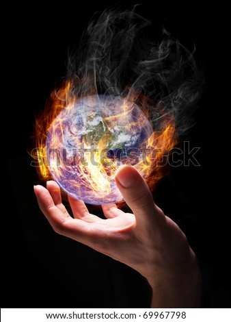Man holding burning Earth in his hand as a symbol of global warming or an apocalypse. Earth globe image provided by NASA (http://visibleearth.nasa.gov/view_rec.php?id=2429). - stock photo