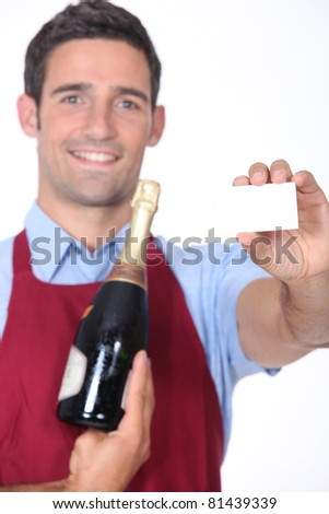 Man holding business card - stock photo