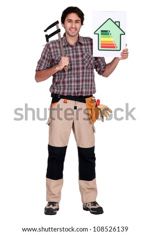 Man holding caliper and energy rating poster - stock photo