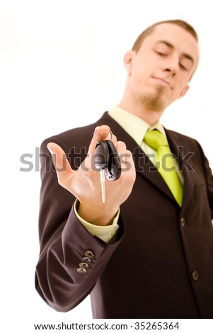 man holding car keys on white - stock photo