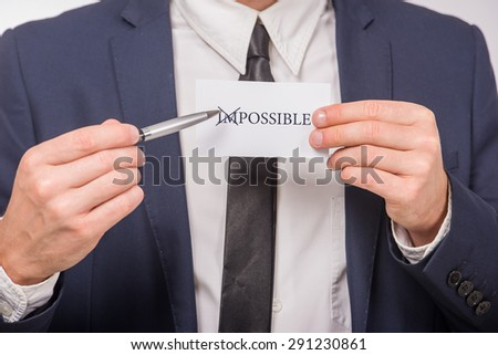 Man holding card with motivational message text written on it. - stock photo