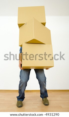 Man holding cardboards. Front view, whole body. Gray background