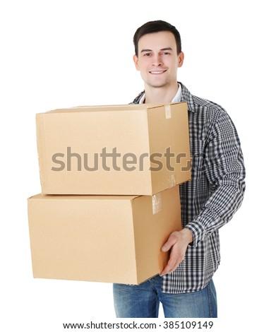 Man holding carton boxes isolated on white background - stock photo