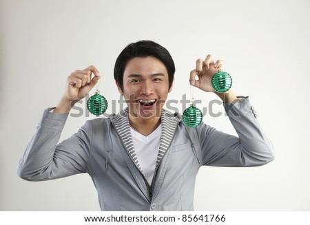 man holding Christmas Decoration on  White Background - stock photo