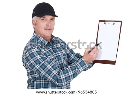 Man holding clip-board and pen - stock photo