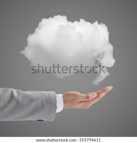 Man holding cloud in hand - stock photo