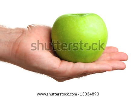 Man holding delicious green apple, isolated on white - stock photo