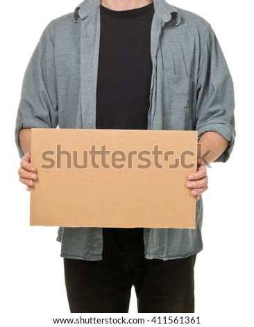 Man holding empty cardboard sign with copy space over white background