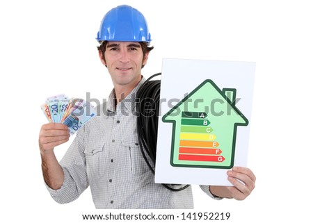 Man holding energy-rating poster and cash - stock photo