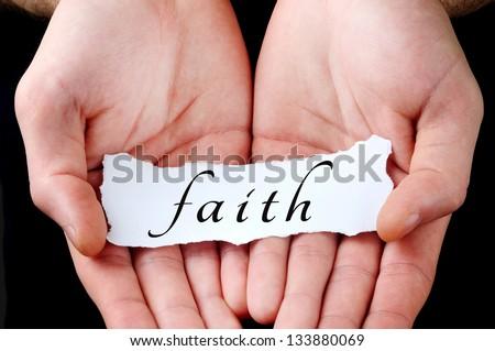 Man holding faith word in palm - stock photo