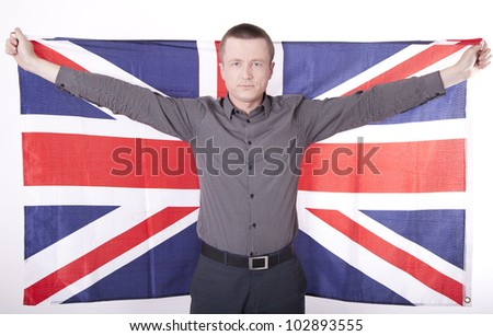 Man holding flag of Great Britain with both hands.