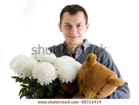 Man holding flowers and teddy bear present