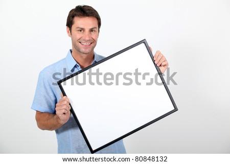 man holding frame - stock photo