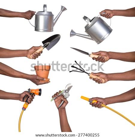 Man holding gardening tools  - stock photo