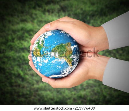 Man holding global in hands - stock photo