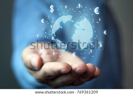 Man holding globe with dollar and euro symbols. Concept of global business.