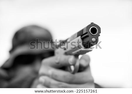 Man holding gun - stock photo