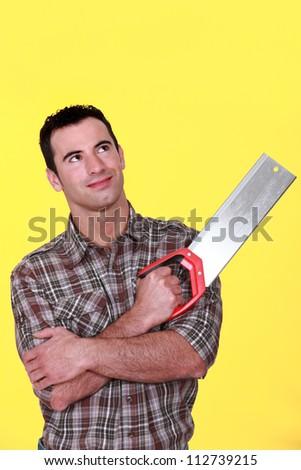 Man holding hand saw - stock photo