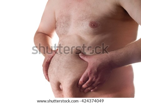 Man holding his big fat belly isolated on white background - stock photo