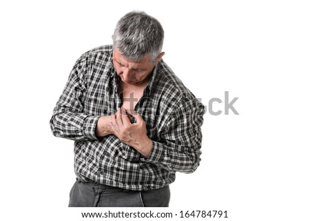 man holding his chest - maybe a heart attack - stock photo