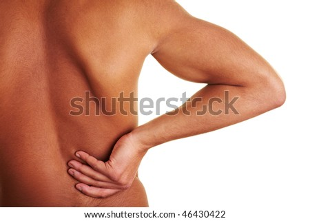 Man holding his hand to his injured back - stock photo