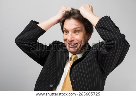man holding his hands on his head stress