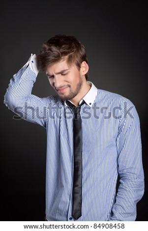 Man holding his head, stressed, headache, depressed - stock photo