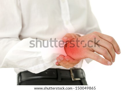 Man holding his injured painful wrist. Red spot emphasizing hurt area. - stock photo