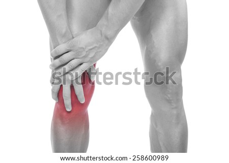 Man holding his painful knee, isolated on white background - stock photo
