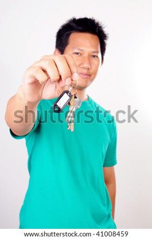 Man holding house keys - stock photo