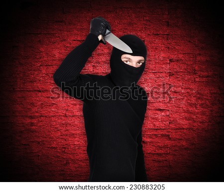 man holding knife on a red background - stock photo