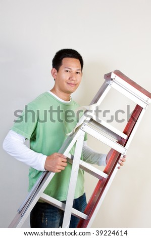 Man holding ladder - stock photo