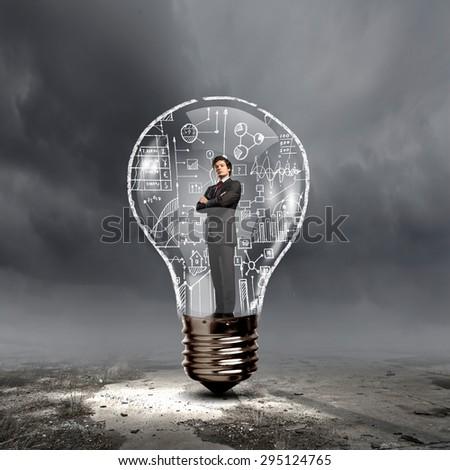 Man holding luminous idea inside light bulb - stock photo