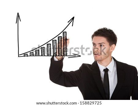 Man holding marker writing profit growth chart on white screen