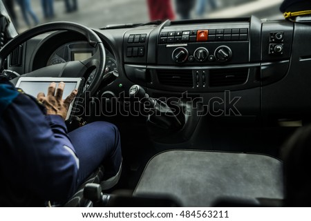man holding mobile phone with gps application in the car with tablet screen computer