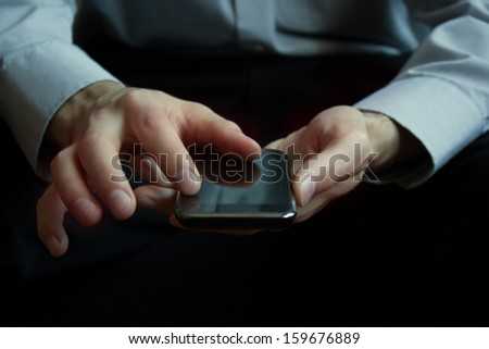 Man holding mobile smart phone