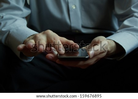 Man holding mobile smart phone - stock photo