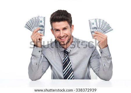Man holding money  - stock photo