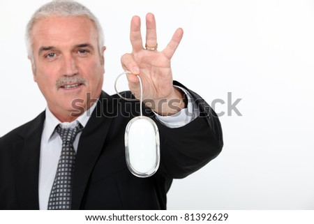 Man  holding mouse of a computer in hand - stock photo