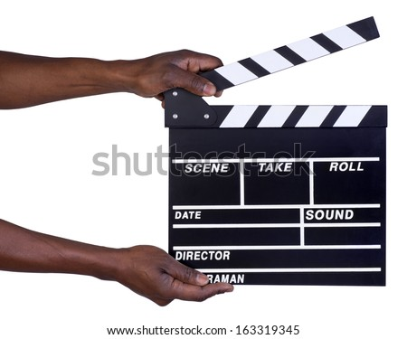 Man holding movie production clapper board isolated on white background - stock photo
