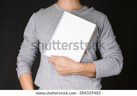 Man Holding note book .education concept - stock photo