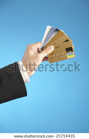 man holding numerous credit cards - stock photo