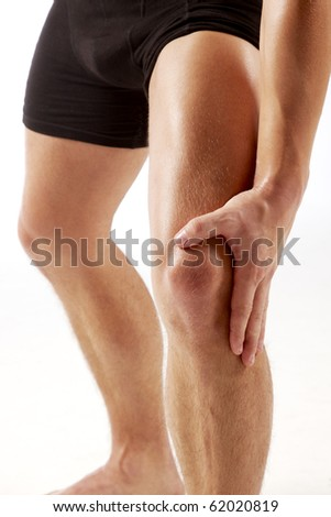 Man holding on knee - stock photo