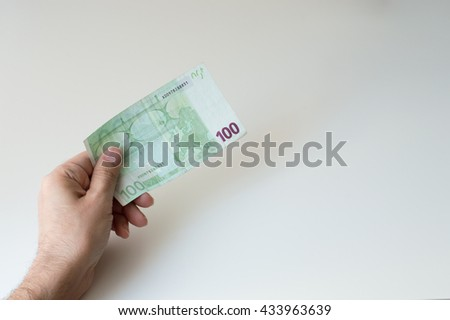Man holding one hundred Euro banknote in his hands